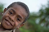 Cheerful fijian boy, Navala, Viti Levu, Fiji Islands, South Pacific, Oceania