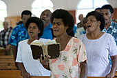 People singing at church service at the village Naidi, Vanua Levu, Fiji Islands, South Pacific, Oceania