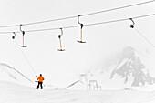 Skier using a drag lift, Hintertux, Tyrol, Austria