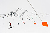 Skiers on slope, chairlift in background, Hintertux, Tyrol, Austria