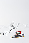 Snow groomer, chairlift in background, Hintertux, Tyrol, Austria