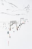 Skiers on slope with ski lift, Hintertux, Tyrol, Austria