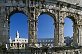 Roman amphitheater under blue sky, Pula, Croatian Adriatic Sea, Istria, Croatia, Europe