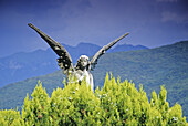 Angel behind a hedge, Morcote, Ticino, Switzerland, Europe