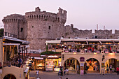 Restaurants and fortification at the Old Town at dusk, Rhodes city, Rhodes, Greece, Europe