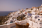 View from a balcony at houses at a mountainside, Oia, Santorini, Greece, Europe