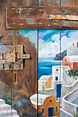 Painted door at Aithra Gallery and Atelier, Oia, Santorini, Greece, Europe