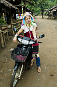 A Padong woman on her scooter