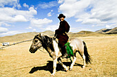 Most Mongolians live in the vast grasslands raising cattle and horses  they roam the land on their horses