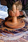 Potter at work, San Isidro medieval fair, Castalla. Alicante province, Comunidad Valenciana, Spain