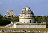 El Caracol (means 'snail' or 'winding staircase) observatory tower and pyramid of Kukulcan in background, Mayan ruins of Chichen Itza. Yucatan, Mexico