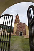 Architecture, Building, Buildings, Church, Churches, Color, Colour, Conca Mission, Daytime, Door, Doors, Exterior, Frame, Framing, Franciscan mission, Franciscan missions, Iron gate, Iron gates, Mexico, Misión Concá, Mission Conca, Nobody, Open, Outdoor,