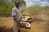 Man presenting lunch in the Tarangire Safari Camp, Tanzania
