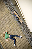Accident, Accidents, Asphalt, Color, Colour, Daytime, Dead, Death, Exterior, Fall, Falling, From above, Ground, Grounds, Negative, Negative concept, One, One person, Outdoor, Outdoors, Outside, Single person, Street, Streets, Victim, Victims, View from ab