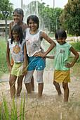 Leticia, Patricia, Claudesi and Eleigi, in Baliza, Roraima, one day of tropical rain. Brazil.