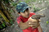 Child with toy gun in one of the Amazone communities, Cametá. Brazil.