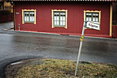 Cities, City, Color, Colour, Daytime, Europe, Exterior, House, Houses, Nobody, Outdoor, Outdoors, Outside, Road, Roads, Sign, Signs, Stockholm, Street, Streets, Sweden, Thoroughfare, Thoroughfares, Wet, V07-702650, agefotostock