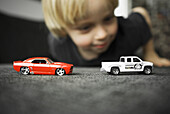 Auto, Automobile, Automobiles, Autos, Blurred, Boy, Boys, Car, Cars, Child, Children, Color, Colour, Contemporary, Daytime, Europe, Exterior, Fitted carpet, Fitted carpets, Floor, Floors, Human, Kid, Kids, Leisure, Male, Moquette, Moquettes, Object, Objec