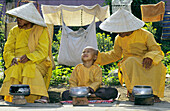 Budhist's monks waiting for alms in the courtyard of Giac Lam pagoda, Ho Chi Minh Ville, Vietnam