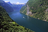 A cruising ship, in the Geiranger fjord and on right the 'seven sister waterfall' on the left in the foreground the farms of Skagfela, More de Fjordane, Norway