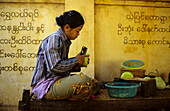 Woman peeling mangoes, Myanmar
