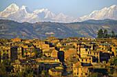 The former royal city of Bhaktapur in front of Everest range, valley of Kathmandu, Nepal
