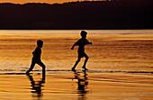 Fishermen children playing on the beach of Doljo, Panglao island, Bohol, The Philippines