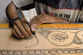 Sri Kalahasti is famous for Kalamkari, a method of painting natural dyes on cotton or silk with a bamboo pen. Figures of gods, trees and birds are first drawn on the fabric and then painted.