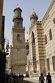 Al-Muizz li-Din Allah Street in Cairo & minarets of sultan Qalawun sultan al-Zahir barquq Madrasa & mosque. Egypt