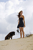 Adult, Adults, Animal, Animals, Barefeet, Barefoot, beach, beaches, Brown hair, Brown haired, Caucasian, Caucasians, Chestnut hair, Color, Colour, Companion, Companions, Contemporary, Daytime, Dog, Dogs, Domestic animal, Domestic animals, Dress, Dresses,