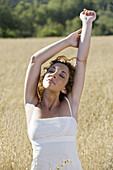 Adult, Adults, Arms raised, Brown hair, Brown haired, Brunette, Brunettes, Calm, Calmness, Carnal, Carnality, Caucasian, Caucasians, Chestnut hair, Closed eyes, Color, Colour, Contemporary, Country, Countryside, Curly hair, Dark-haired, Daytime, Dress, Dr