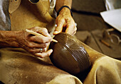 Craftsmans hands making a ceramic bowl, Villa de Mazo, La Palma island, Canary Islands, Spain