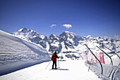 Skier with Bernina range, Diavolezza, Pontresina, Upper Engadin, Grisons, Switzerland