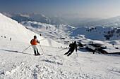 Skiers on a ski slope at Kitzbuehel Alps, Tyrol, Austria, Europe