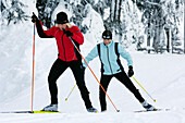 Two young women cross-country skiing, Tyrol, Austria, Europe