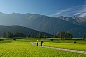 A couple nordic walking in an idyllic scenery, Tyrol, Austria, Europe