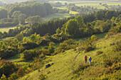 Two women hiking in an idyllic landscape, Franconian Switzerland, Bavaria, Germany, Europe