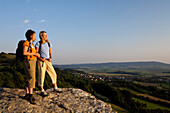 Two women looking at the view in the evening sun, Franconian Switzerland, Bavaria, Germany, Europe