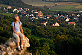 Woman on a mountain looking at the view, Walberla, Bavaria, Germany, Europe