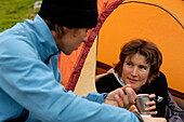 Young couple drinking tea at the tent, Tyol, Austria, Europe