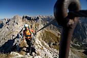 Woman on the Mittenwalder Klettersteig, Mittenwalder Hoehenweg, Fixed rope climbing, Karwendel mountain, Mittenwald, Upper Bavaria, Bavaria, Germany
