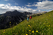Family hiking in the mountains, Tannheimer Mountains, Allgaeu Alps, Tirol, Austria, Europe