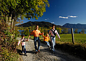 Family hiking at Lake Tegernsee, Hand in Hand, Upper Bavaria, Bavaria, Germany, Europe