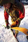 Woman attaching sking to her skis, Ski tour at Hochgrat, Allgaü Alps, Bavaria, Germany, Europe