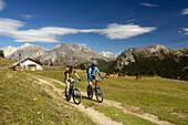 Couple on a mountain bike tour, MTB, mountainbiking near Tschierv, near Ofenpass, Sesvenna Mountain Range, Grisons, Switzerland