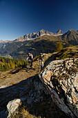 Couple on a mountain bike tour, MTB, mountainbiking near Svognin, View towards Albula Range, Grisons, Switzerland