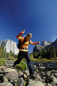 Mid adult woman jumping, Yosemite National Park, California, USA