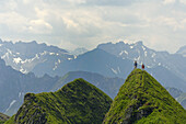 Hikers on hilltop, Allgaeu Alps, Bavaria, Germany