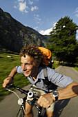 Man riding bicycle, Oberstdorf, Bavaria, Germany