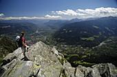 Woman enjoying view over valley near Merano, Trentino-Alto Adige/Südtirol, Italy